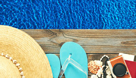 Beach items at pool. Travel and beach items at pool stock photo