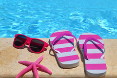 Beach items by the poolside Royalty Free Stock Photo