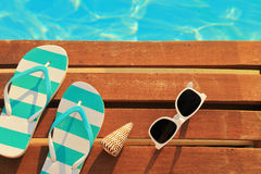 Beach items by the poolside Royalty Free Stock Image