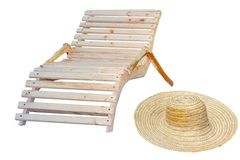 Beach items. For relaxation in the sun - wooden chair and sombrero Stock Images