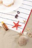 Beach items on sand for fun summer Royalty Free Stock Photos