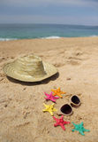 Beach items, sand and starfishes Royalty Free Stock Photo