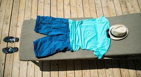 Beach items with straw hat. Flip flops and sunglasses Royalty Free Stock Images