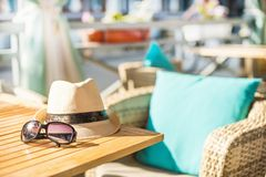 Beach items with straw hat. And sunglasses Royalty Free Stock Images