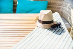 Beach items with straw hat. And sunglasses Stock Photos