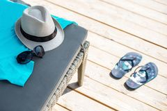 Beach items with straw hat. And sunglasses Royalty Free Stock Photography