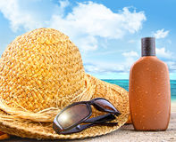 Beach items and suntan lotion at the beach royalty free stock images