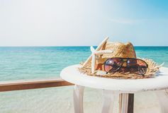 Beach items on the table with bright beach. Background Royalty Free Stock Photography