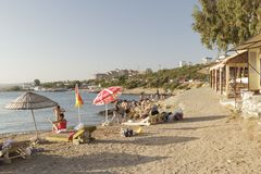 Beach in Izmir, Turkey. Izmir, Turkey - July 16, 2016: Izmir`s Seferihisar coast, is a beautiful place to relax and swim. Turks and tourists are enjoying the sea Royalty Free Stock Images