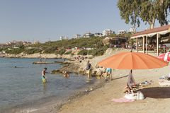 Beach in Izmir , Turkey. Izmir, Turkey - July 16, 2016: Izmir`s Seferihisar coast, is a beautiful place to relax and swim. Turks and tourists are enjoying the Royalty Free Stock Image