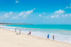 Beach of Joao Pessoa city with sand bay and a beautiful blue water ocean. Stock Photography