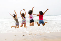 Beach jump. Young teen girls jump on beach Stock Photography