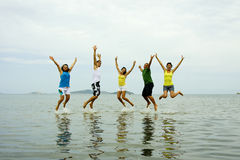 Beach Jumping. Young people jumping on the beach Stock Photography