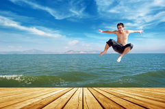Beach jumping man Royalty Free Stock Images