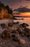 The beach in Kalamata. Picture of the rocky beach in Kalamata, photographed during a glowing sunset Royalty Free Stock Images