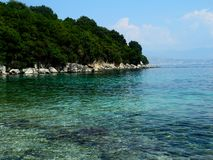 Beach in Kassiopi, Corfu, Greece Royalty Free Stock Photo