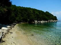 Beach in Kassiopi, Corfu, Greece Royalty Free Stock Photography