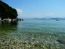 Beach in Kassiopi, Corfu, Greece Royalty Free Stock Images