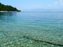 Beach in Kassiopi, Corfu, Greece Stock Photo