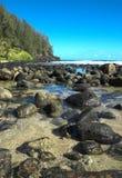 Beach in Kauai, Hawaii. A rocky tropical beach in Kauai, Hawaii Stock Images