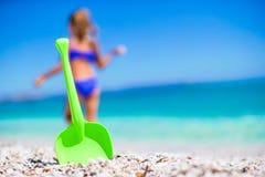 Beach kid's toys on white sand Stock Images