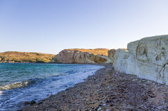 Beach in Kimolos island, Cyclades, Greece, early in the morning Royalty Free Stock Images