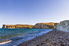 Beach in Kimolos island, Cyclades, Greece, early in the morning Stock Images