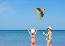 Beach kite children siblings play fun. Together royalty free stock photography