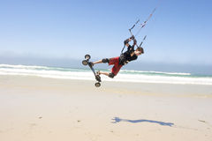 Beach Kiteboarding. Young man kiteboarding on the beach Stock Image