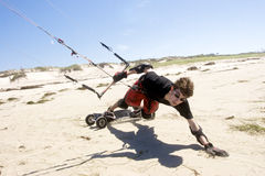 Beach Kiteboarding. Young man kiteboarding on the beach Royalty Free Stock Photo