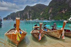 Beach on Ko Phi Phi, Thailand with long tail boats Royalty Free Stock Photo