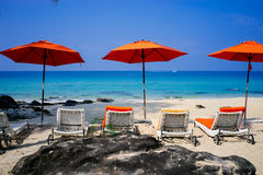 Beach in koh kood,Thailand. 3 umbrellas and 4 chairs on the beach at Koh Kood Royalty Free Stock Photography