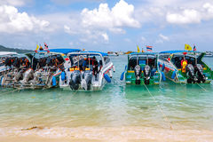 Beach of Koh Phi Phi Don. Speed boats and drivers waiting for tourists on the beach Royalty Free Stock Image