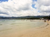A beach in Koh Samui. Koh Samui, Thailand - 04 August 2017: a beautiful beach on the island of Koh Samui, Thailand. Some people relaxing and walking on the Royalty Free Stock Images