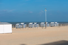 Beach in Koksijde, Belgium on the North Sea with beach huts.  Stock Photography
