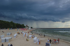 Beach in Kolobrzeg and dramatic heavy clouds in the sky Royalty Free Stock Image