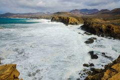 Beach La Pared on Fuerteventura, Spain. Beach La Pared in a stormy day with strong waves on the Canary Island Fuerteventura, Spain Stock Photos