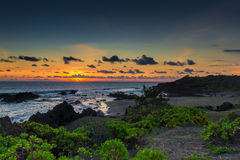 Beach in la Reunion Island at sunset Stock Photos