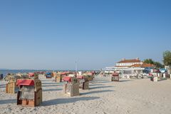 Beach in Laboe. Beach with canopied wicker beach chairs in Laboe at the Baltic Sea Royalty Free Stock Photos