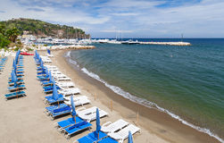 Beach of Lacco Ameno, Ischia island, Italy. Empty sandy beach of Lacco Ameno commune, Ischia island, Italy Royalty Free Stock Images