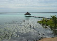Beach lagoon Bacalar Mexico lake panorama hut Stock Photography