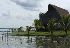 Beach lagoon Bacalar Mexico lake panorama hut Royalty Free Stock Photo
