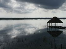 Beach lagoon Bacalar Mexico lake panorama hut Royalty Free Stock Photos