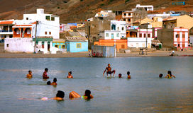 Beach and lagoon. Swimmers at the Beach and lagoon in Sao Pedro in Cape Verde Stock Photography