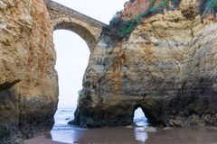 Beach in Lagos, Portugal with rock bridge royalty free stock image