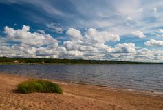 On the beach of the lake. This picture was taken on the beach of the lake. It was a windy day with beautiful clouds Stock Image