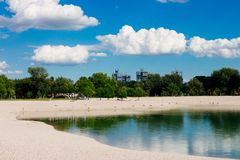 Beach by the lake on a bright and sunny day Royalty Free Stock Image