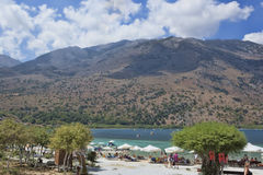 Beach on the lake Kournas, the largest freshwater lake in Crete Royalty Free Stock Photography