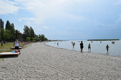 Beach on Lake Neusiedl in Austria. A clean and well-groomed beach at Lake Neusiedl in Austria. A favorite and maintained place for relaxation and bathing. The royalty free stock images