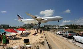 Beach landing in St. Maarten. An international flight arrives at Princess Juliana International Airport in St. Maarten Royalty Free Stock Photography